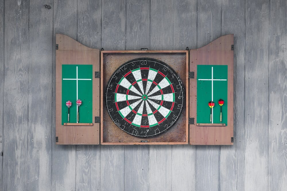 dart board on a blue wall