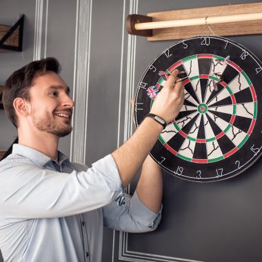 man taking darts