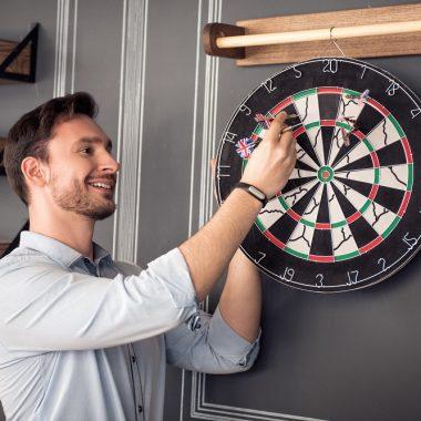 man taking darts