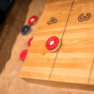 Red puck on shuffleboard