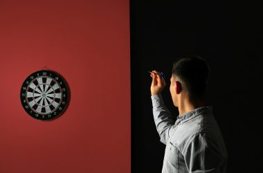 Young man playing darts
