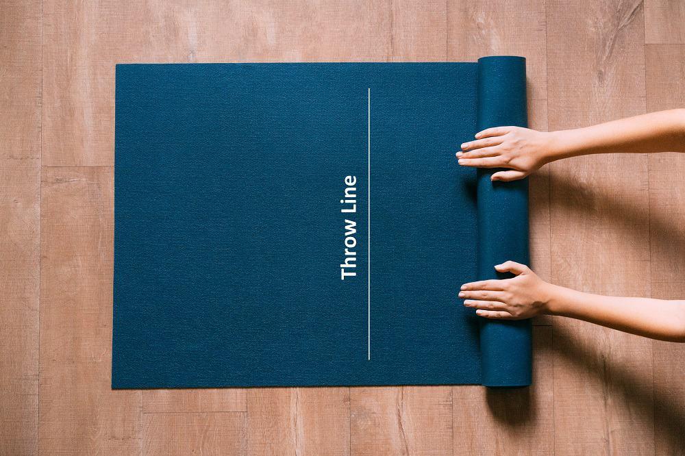 Woman folding blue mat