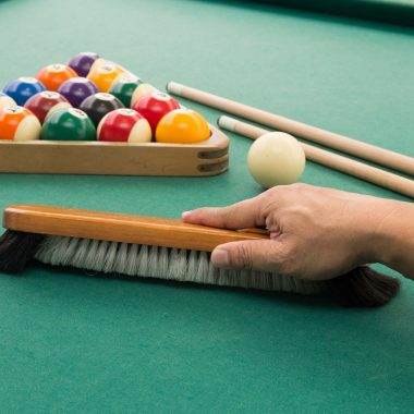 Hand brushing pool table
