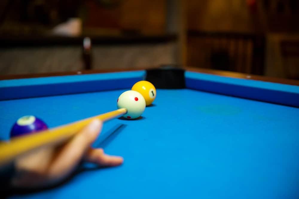 Pool balls on the blue felt