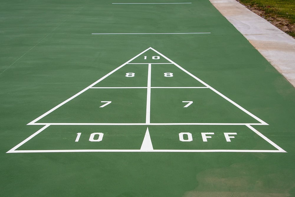 white and green painted shuffleboard
