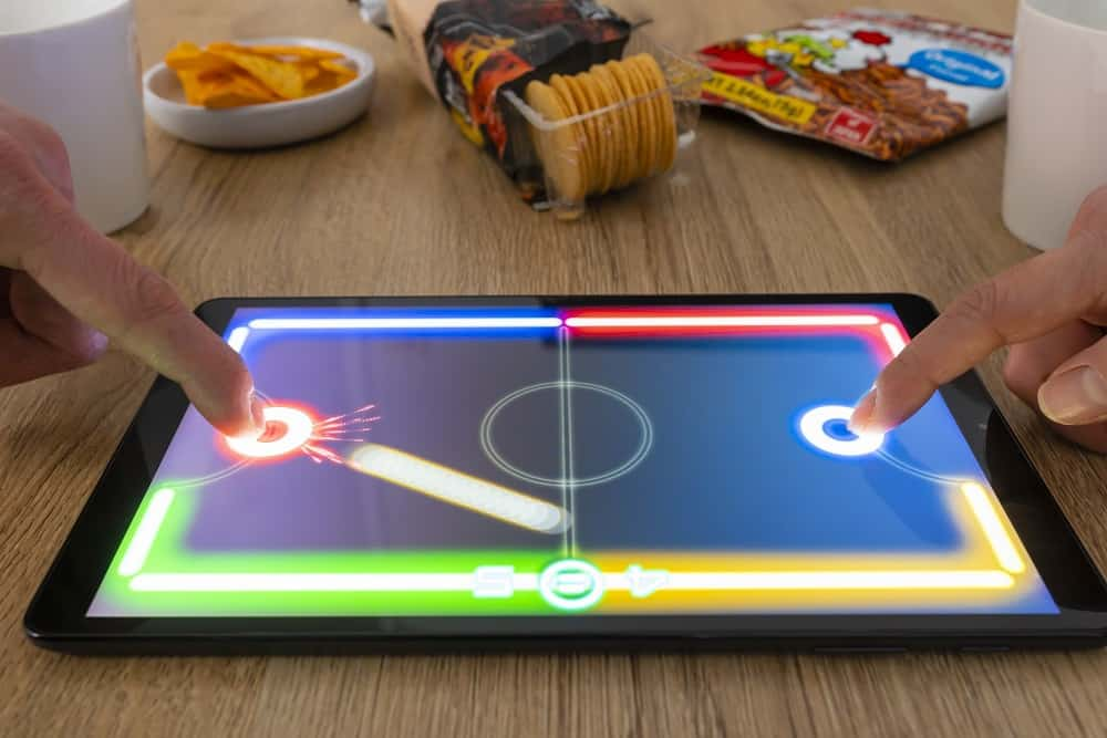 Playing hockey game on a tablet