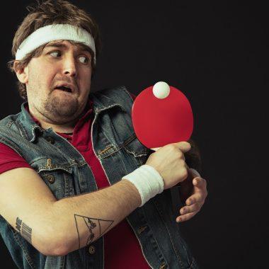 funny man playing ping pong