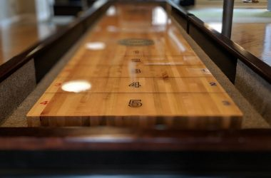 polished shuffleboard table surface
