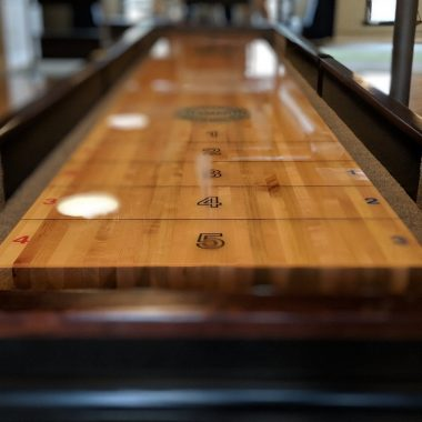 polished shuffleboard table surface