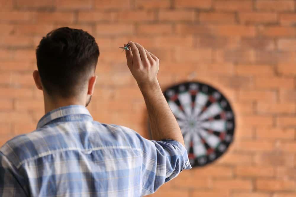 Young man playing darts