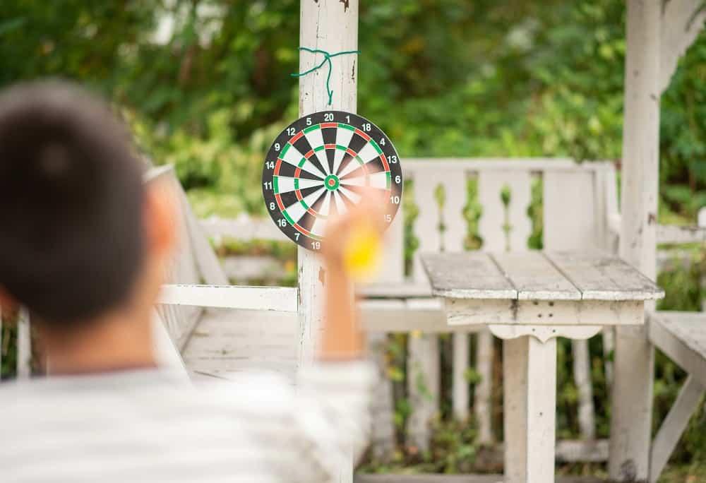 Little boy playing darts