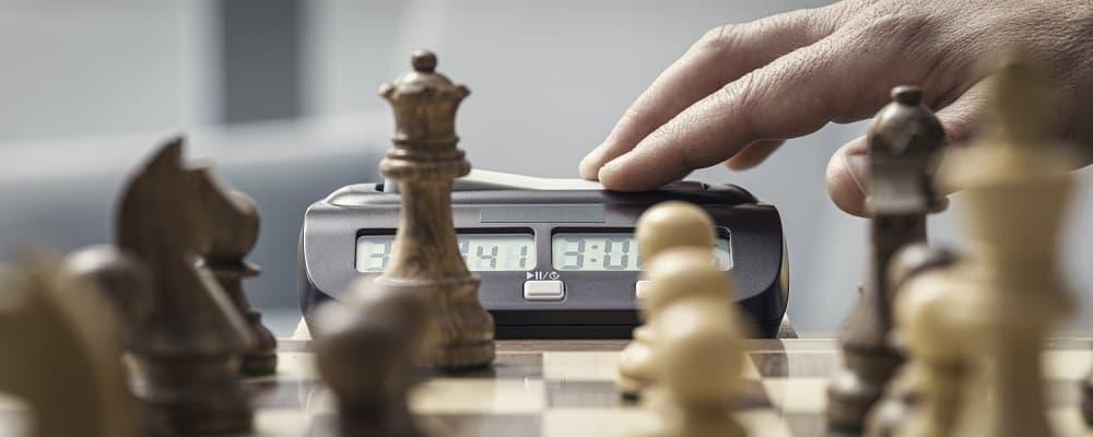 Chess player hitting the chess clock