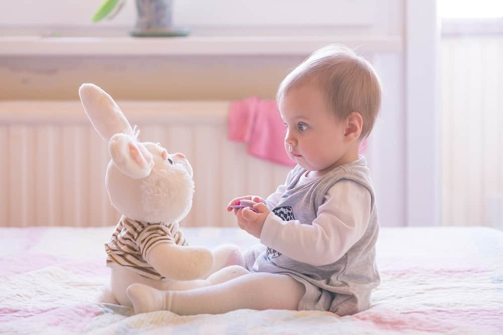 baby girl with bunny